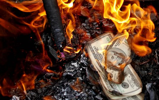 Fake U.S. dollar banknotes are burnt during a ceremony to honour deceased ancestors in the old quarter of Hanoi October 26, 2010. According to Vietnamese tradition, people burn items made of paper, such as money, cloths and vehicles, during the ceremony. Leaders from the 10 ASEAN states plus China, Japan, India, South Korea, Australia, New Zealand and others convene in Hanoi for the ASEAN summit this week with the currency issue as one of the main topics to discuss.